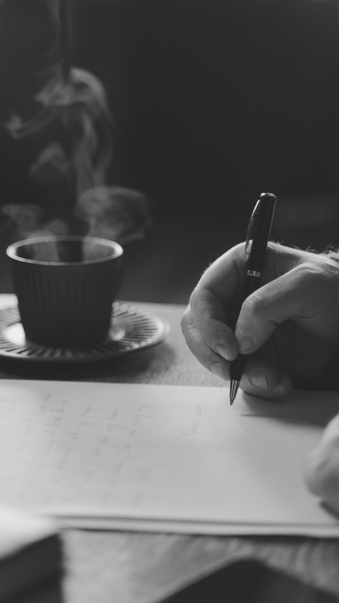 person writing with coffee